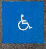 Handicap Parking Spot Symbol. Freshly painted handicap parking spot symbol in the town hall parking lot for Chesapeake Beach, Maryland USA royalty free stock photography
