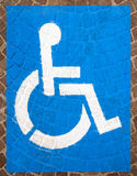 Handicap Parking Spots. Blue and white road marking for disabled parking on floor with blocks of porphyry Stock Photos
