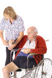 Handicap patient and nurse Stock Photography