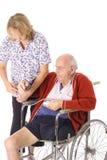 Handicap patient and nurse Stock Photography