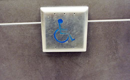 Handicap push button door opener Stock Images