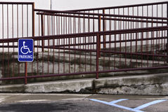 Handicap Ramp. A handicap ramp with red railings and cement sloped elevations Stock Image