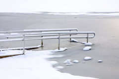 Handicap ramp. Handicap wheel chair ramp down into the frozen lake stock photography