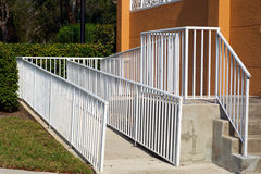 Handicap ramp with white railing Royalty Free Stock Photography