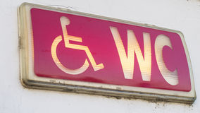 Handicap restroom illuminated sign Stock Images
