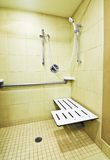 Handicap Shower. The fold down seat helps the disabled and handicap use the shower easier with access at the height of a wheelchair. The adjustable shower handle Royalty Free Stock Photography