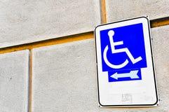 Handicap sign. White handicap sign on blue background Stock Photo