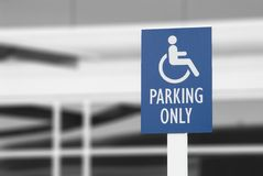 Handicap sign. Handicap parking sign outside city building Royalty Free Stock Image