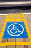 Handicap sign. Yellow sign for parking space reserved for disabled people Royalty Free Stock Photography