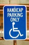 Handicap sign. Blue metal handicap parking sign Royalty Free Stock Images