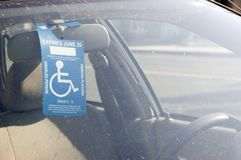 Handicap Sign on a Rear View Mirror Royalty Free Stock Photo