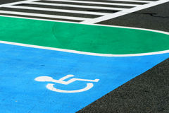 Handicap sign on the road surface Stock Images