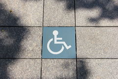 Handicap sign on tile floor. Disable symbol Royalty Free Stock Images