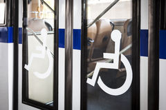 Handicap signange on bus door entrance Royalty Free Stock Image
