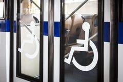 Handicap signange on bus door entrance. Handicap signage on bus door entrance Transportation Facility Royalty Free Stock Image