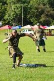 Handicap Stone Putter – Highland Games, Salem, VA. Salem, VA – August 27th; Competitor with prosthetic leg competing in the Stone Putter at the 2016 Green Stock Images