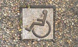 Handicap tile in ground. Handicap sign in park Royalty Free Stock Photos