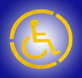 Handicap yellow parking sign on asphalt, persons with disabilities. On blue background Royalty Free Stock Photo