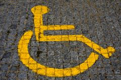 Handicaped sign. Yellow parking sign for handicaped people.Painted on the pavement royalty free stock photos
