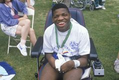 Handicapped African American Athlete cheering at finish line, Special Olympics, UCLA, CA Stock Photo