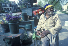 Handicapped African-American flower seller Royalty Free Stock Images