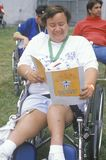 Handicapped Athlete cheering at finish line Stock Photos