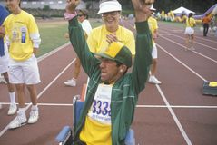 Handicapped Athlete cheering at finish line, Special Olympics, UCLA, CA Stock Image