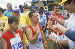 Handicapped Athletes cheering. Special Olympic games, UCLA, CA Royalty Free Stock Images