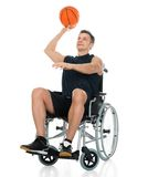 Handicapped basketball player throwing ball Stock Photo