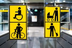 Handicapped, bicycle, stroller and big luggage yellow pictrogram in metro, information in public transport, no people stock image
