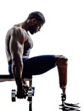 Handicapped body builders building weights man with legs prosthe Stock Photography