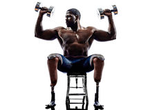 Handicapped body builders building weights man with legs prosthesis silhouette. One muscular handicapped man body builders building weights with legs prosthesis stock photos