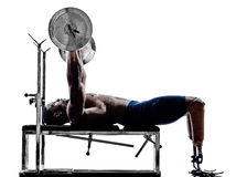 Handicapped body builders building weights man with legs prosthe Royalty Free Stock Photography