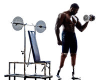Handicapped body builders building weights man with legs prosthesis silhouettes. One muscular handicapped man body builders building weights with legs prosthesis stock photos