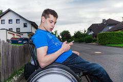 Handicapped boy with smartphone Stock Photo