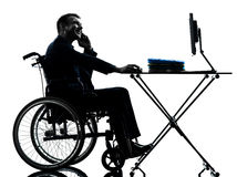 Handicapped business man working in wheelchair silhouette in whe Stock Image