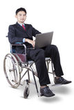 Handicapped businessman using laptop Royalty Free Stock Photography
