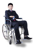 Handicapped businessman in wheelchair Stock Images