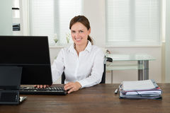 Handicapped Businesswoman Working On Computer Royalty Free Stock Photos
