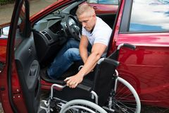Handicapped car driver with a wheelchair Royalty Free Stock Photos