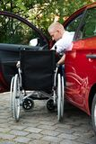 Handicapped car driver with a wheelchair Royalty Free Stock Photography