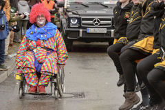 Handicapped clown and dancing line at Carnival parade, Stuttgart Royalty Free Stock Photography