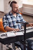 Handicapped composer recording songs Royalty Free Stock Image