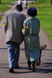 Handicapped couple. Blind Couple walking with their dog Royalty Free Stock Photo