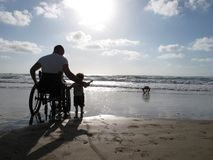 Handicapped Dad with Child Stock Photo