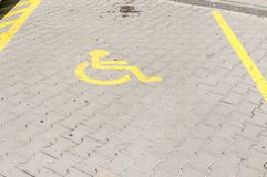 Handicapped disabled icon sign on parking lot or space area in car park in the city street Royalty Free Stock Photo