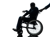 Handicapped disabled man in wheelchair silhouette Stock Photography