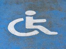 Handicapped or disabled parking sign on blue asphalt stock photography