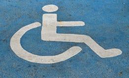 Handicapped or disabled parking sign on blue asphalt Royalty Free Stock Image
