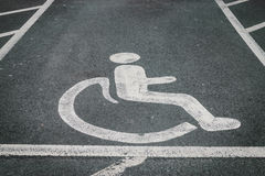 Handicapped / disabled parking sign painted on the road asphalt Royalty Free Stock Image